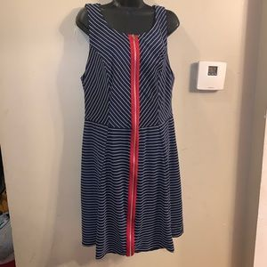 Blue and white dress with a red zipper